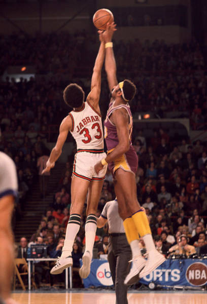 Wall Art - Photograph - Kareem Abdul Jabbar Vs. Wilt Chamberlain Jump Ball by Retro Images Archive