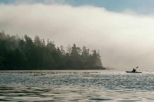Vancouver Island Photograph - Kayaker Approaching Shore Of Bc Island by Stuart Mccall