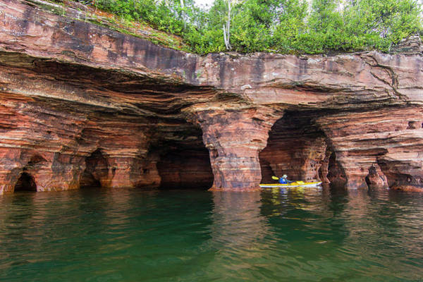 Kayaks Wall Art - Photograph - Kayaker Exploring The Sea Caves by Chuck Haney
