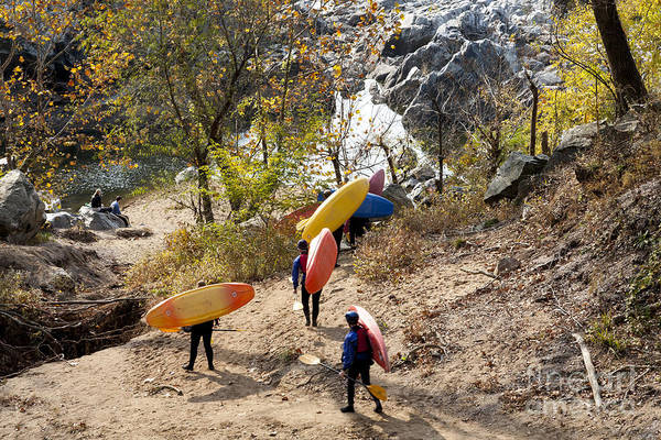 Wall Art - Photograph - Kayakers Carry Their Kayaks Down To The Potomac River Near Great Falls In Maryland. by William Kuta