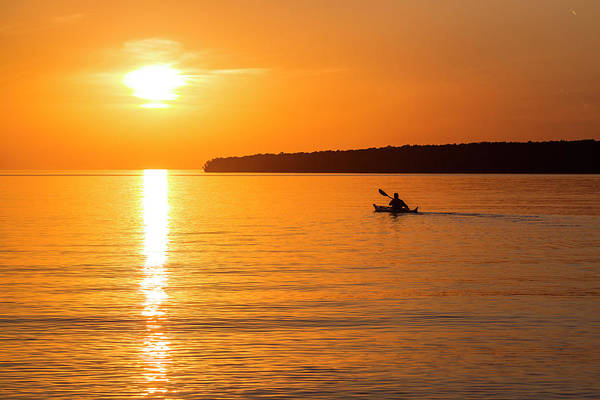 Kayaks Wall Art - Photograph - Kayaking At Sunset In The Apostle by Chuck Haney