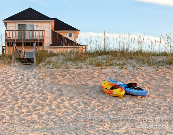 Photograph - Kayaks Rest On Sand Dune In Morning Sun. by Jo Ann Tomaselli