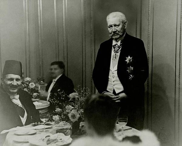 Flower Head Photograph - King Fuad And Paul Von Hindenburg At A Dining by Erich Salomon