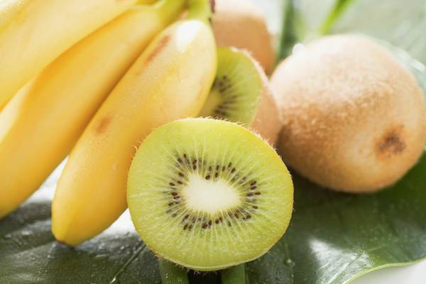 Kiwifruit Photograph - Kiwi Fruit And Bananas by Foodcollection