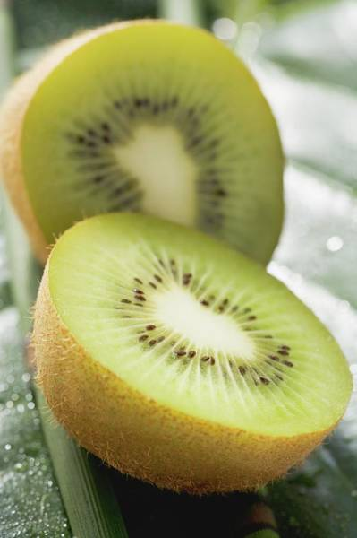 Kiwifruit Photograph - Kiwi Fruit, Halved by Foodcollection