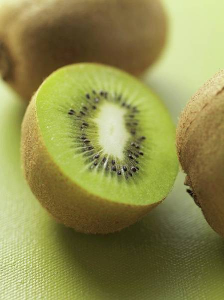 Kiwifruit Photograph - Kiwi Fruits, Whole And Halved by Eising Studio - Food Photo and Video
