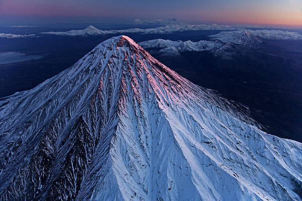 Kamchatka Photograph - Kronotsky Volcano Towers Above Nearby by Michael Melford