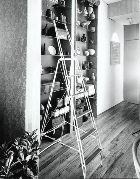 Wall Art - Photograph - Ladder By Shelves by Tom Leonard