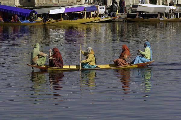 Dal Lake Photograph - Ladies On A Wooden Boat On The Dal Lake by Ashish Agarwal