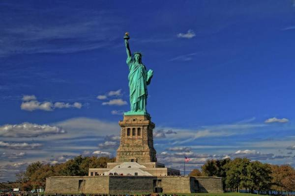 Battery D Photograph - Lady Liberty In New York City by Dan Sproul
