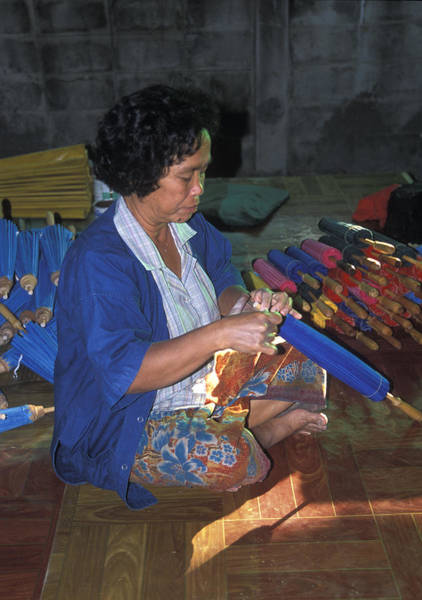 Wall Art - Photograph - Lady Makes Umbrellas At A Factory Near Chaing Mai by Richard Berry