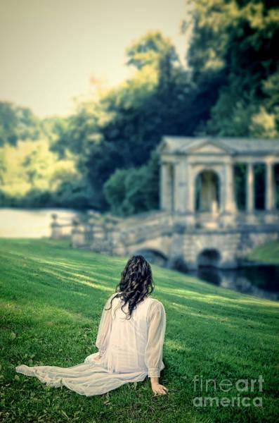 Wall Art - Photograph - Lady Sitting On A Hill Above A Lake by Jill Battaglia