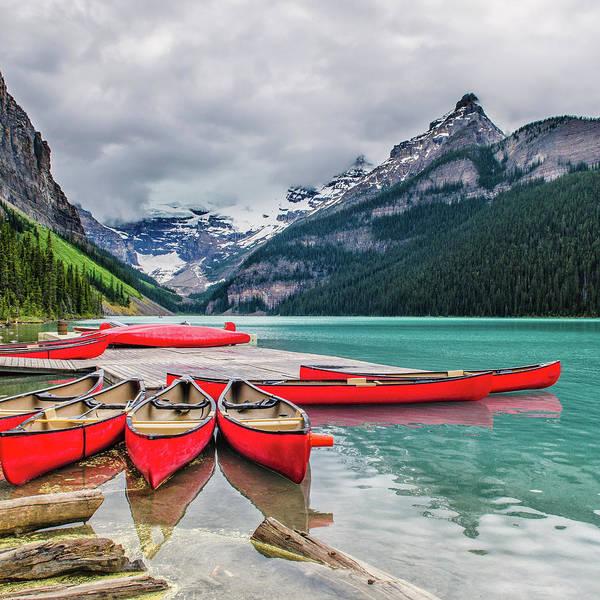 Canoe Photograph - Lake Louise Canoes by Wr Mekwi
