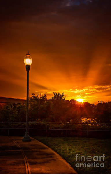 Photograph - Lamp Post Sunset by Larry McMahon