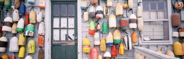 Wall Art - Photograph - Large Group Of Buoys Hanging On A by Panoramic Images
