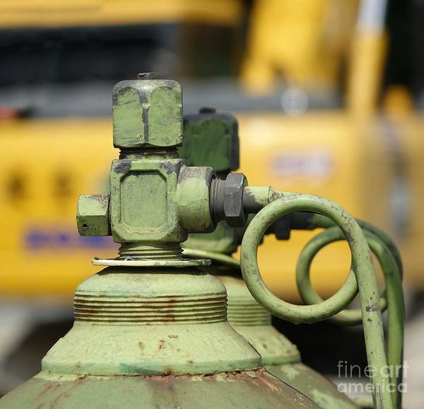 Liquify Photograph - Large Oxygen Bottle At Construction Site by Yali Shi