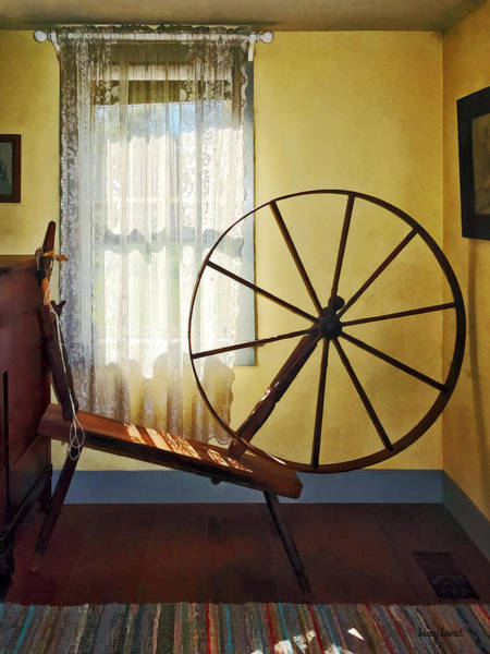 Photograph - Large Spinning Wheel Near Lace Curtain by Susan Savad
