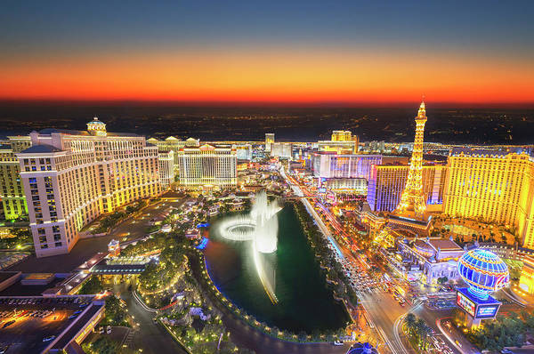 Bellagio Hotel Photograph - Las Vegas Skyline With Glowing Sky At by Mitchell Funk