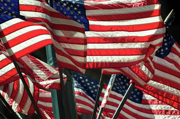 Usa Flag Photograph - Layers Of American Flags Wave In Bright by Peskymonkey