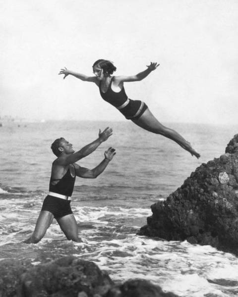 Wall Art - Photograph - Leap Into Life Guard's Arms by Underwood Archives