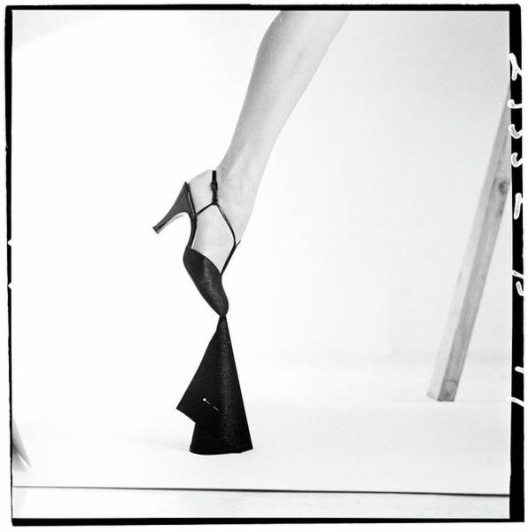 Body Part Photograph - Leg Of A Model Wearing A T-strap Sandal by Richard Rutledge