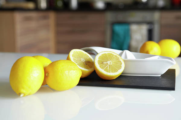 Lemons And Juicer On Kitchen Counter Art Print