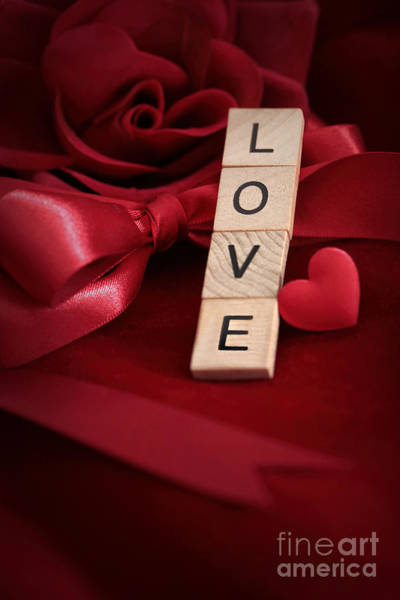 Photograph - Letters Spelling The Word Love With Heart On Red Velvet by Sandra Cunningham