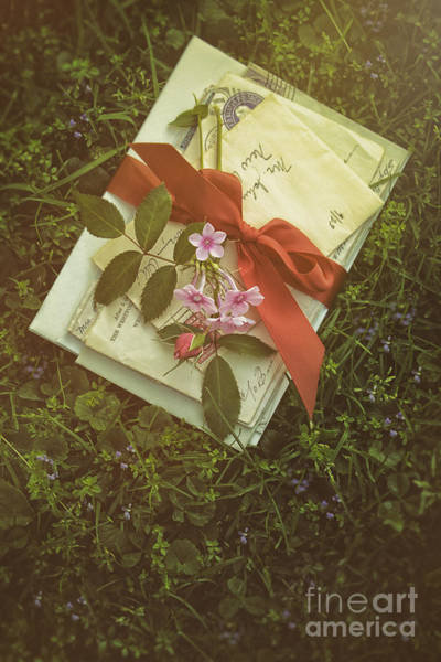 Photograph - Letters With Red Satin Ribbon In The Grass by Sandra Cunningham