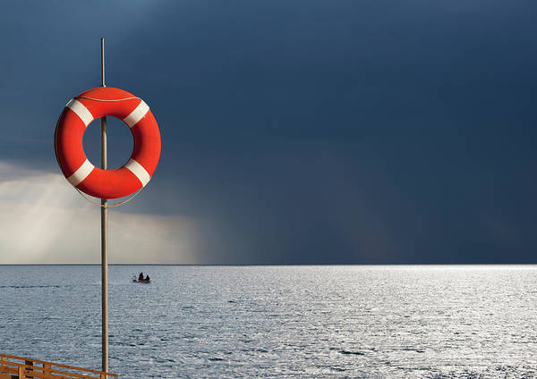 Insurance Photograph - Life Ring Against Dramatic Sky by Luxx Images