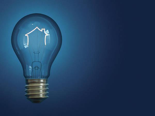 Wall Art - Photograph - Light Bulb Shaped Like House by Ikon Ikon Images