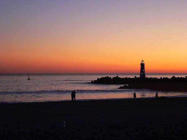 Photograph - Lighthouse And Lovers At Sunset by Jeff Lowe