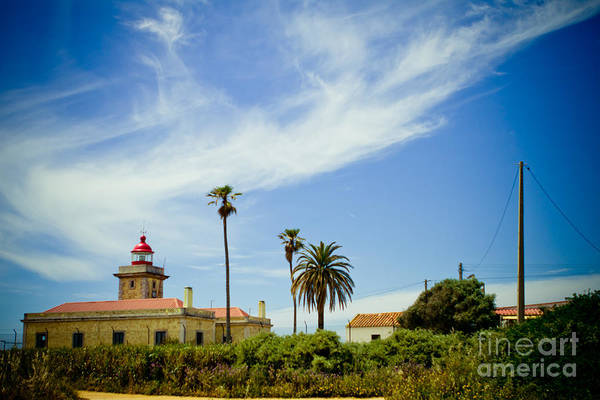 Photograph - Lighthouse At Portugal Coast Lagos by Raimond Klavins