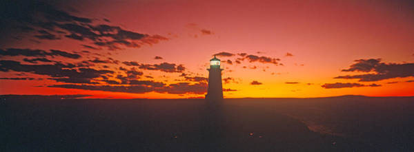 Peggys Cove Photograph - Lighthouse At Sunset, Peggys Cove, Nova by Panoramic Images
