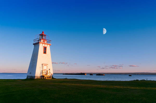 Photograph - Lighthouse In The Light From Moon And Sun by U Schade