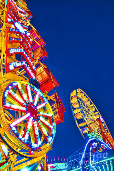 Fairground Photograph - Lighting Up The Night Sky by Olivier Le Queinec