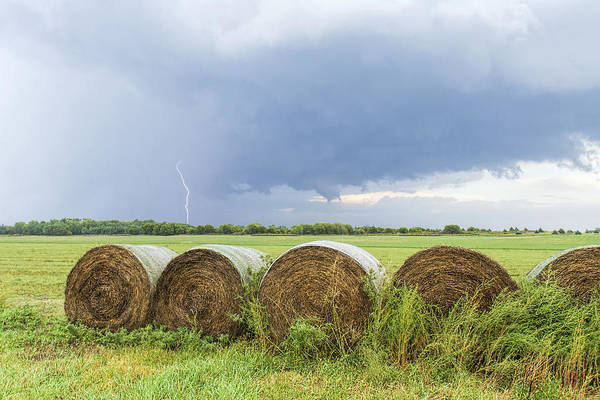 Photograph - Lightning And Round Bales by Rob Graham