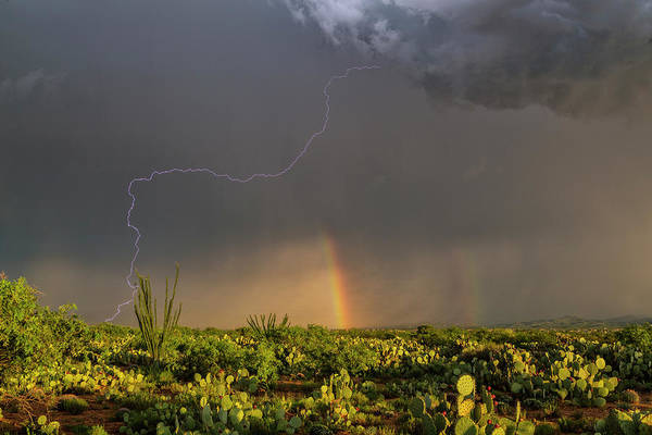 Wall Art - Photograph - Lightning Strike And Rainbow by Roger Hill/science Photo Library