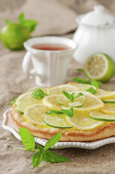 Yellow Photograph - Lime And Lemone Tart by Oxana Denezhkina