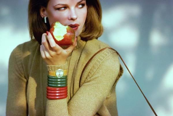 Wall Art - Photograph - Lisa Taylor Eating An Apple by Arthur Elgort