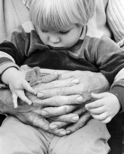 Elder Care Photograph - Little Boy In Grandfathers Arms, C.1980s by Photo Media/ClassicStock