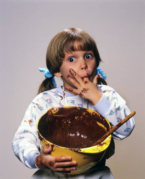 Wall Art - Photograph - Little Girl Eating Chocolate Icing by Vintage Images