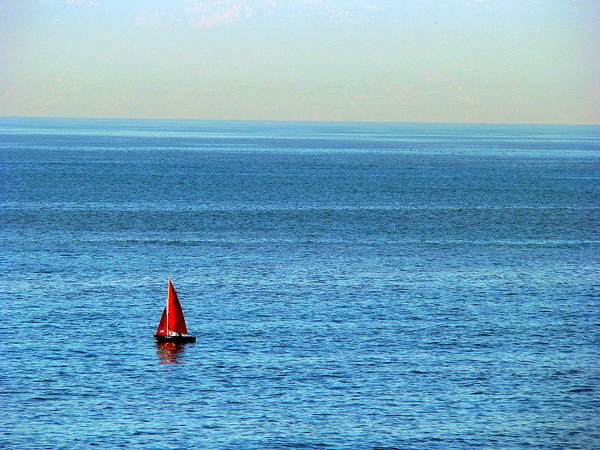 Photograph - Little Red Sailboat Big Sea by Jeff Lowe