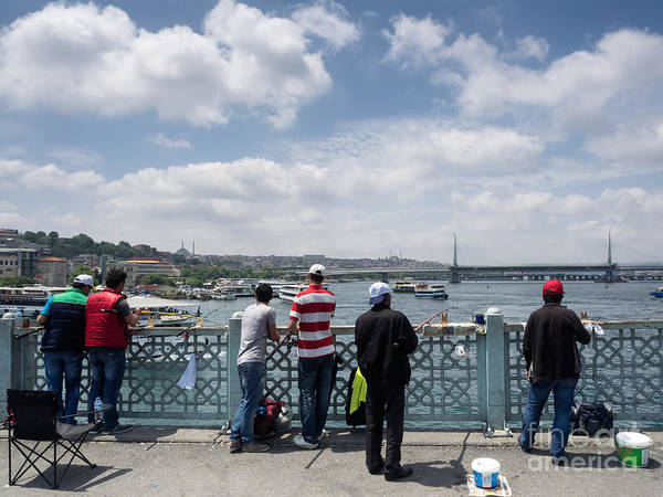Bosphorus Bridge Photograph - Local Fishermen Fishing On The Galata Bridge In Istanbul by Frank Bach