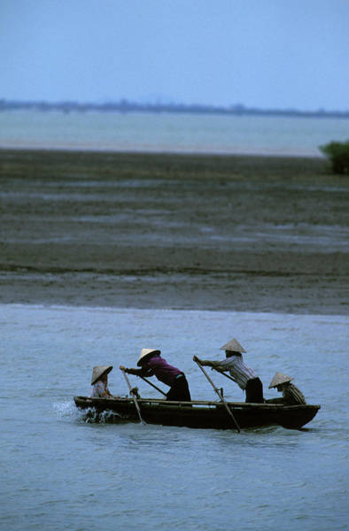 Work Boat Photograph - Local Villagers Rowing A Boat by Corey Rich