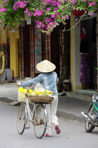 Real People Photograph - Local Woman In Conical Hat With Bike by Danita Delimont