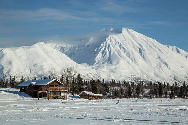 Logs Photograph - Log Cabins On Frozen Lake Shore by Matt Andrew