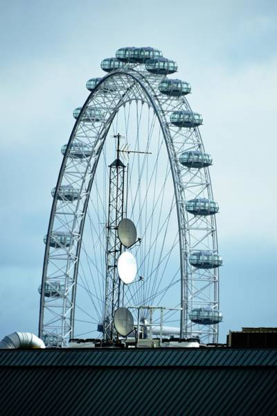 Photograph - London Eye Framing Antennae by Richard Henne