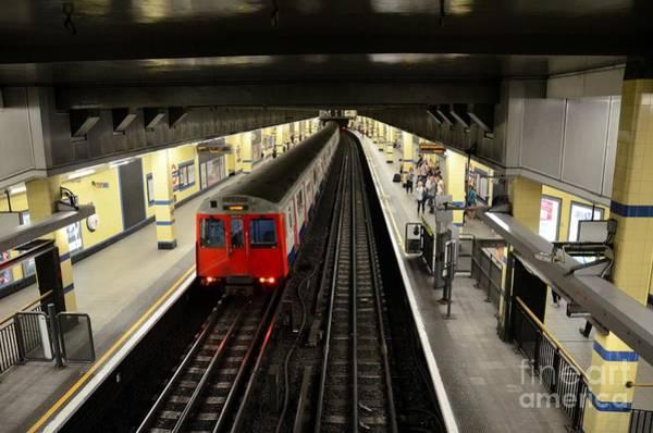 Photograph - London Underground Tube Subway Train Leaves Station Platform by Imran Ahmed