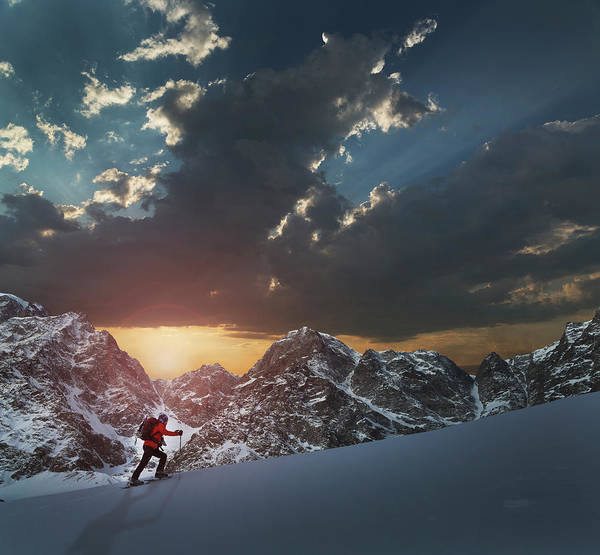 Climbing Photograph - Lone Climber On A Snowy Slope At Sunrise by Buena Vista Images