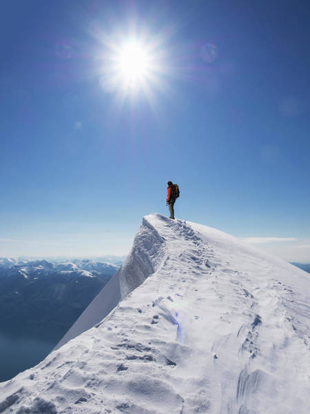 Candid Photograph - Lone Climber On The Top Of A  Mountain by Buena Vista Images